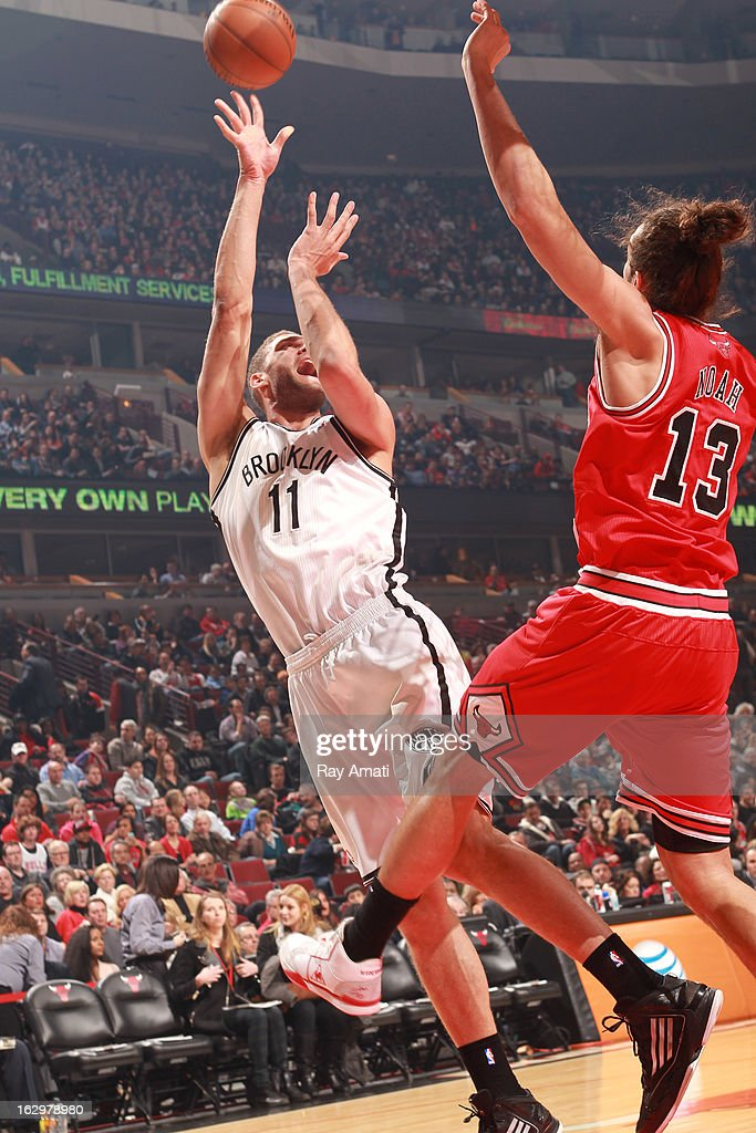 Brook Lopez #11 of the Brooklyn Nets shoots against Joakim Noah #13 of the Chicago Bulls on March 2, 2013 at the United Center in Chicago, Illinois.