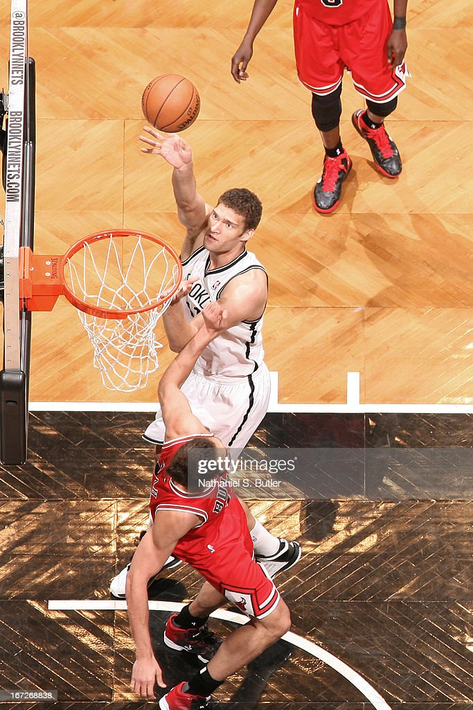 <a gi-track='captionPersonalityLinkClicked' href=/galleries/search?phrase=Brook+Lopez&family=editorial&specificpeople=3847328 ng-click='$event.stopPropagation()'>Brook Lopez</a> #11 of the Brooklyn Nets shoots against <a gi-track='captionPersonalityLinkClicked' href=/galleries/search?phrase=Joakim+Noah&family=editorial&specificpeople=699038 ng-click='$event.stopPropagation()'>Joakim Noah</a> #13 of the Chicago Bulls in Game Two of the Eastern Conference Quarterfinals during the 2013 NBA Playoffs on April 22 at the Barclays Center in the Brooklyn borough of New York City.