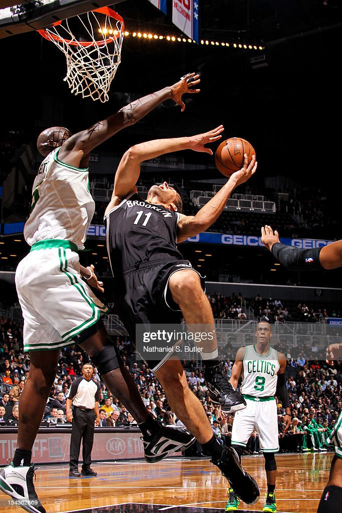 Brook Lopez #11 of the Brooklyn Nets shoots against Kevin Garnett #5 of the Boston Celtics during a pre-season game on October 18, 2012 at the Barclays Center in the Brooklyn borough of New York City.