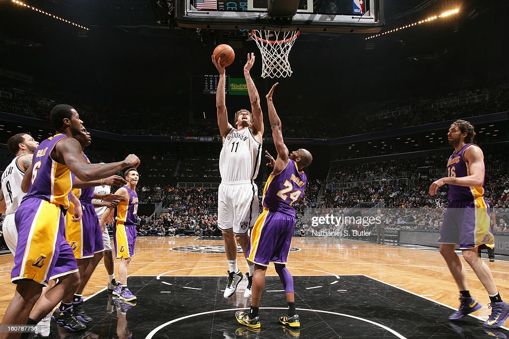 Brook Lopez #11 of the Brooklyn Nets shoots against Kobe Bryant #24 of the Los Angeles Lakers on February 5, 2013 at the Barclays Center in the Brooklyn borough of New York City.