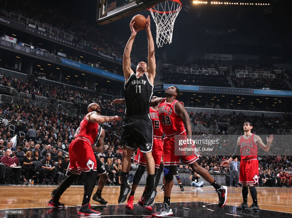 Brook Lopez #11 of the Brooklyn Nets shoots against Nazr Mohammed #48 of the Chicago Bulls in Game One of the Eastern Conference Quarterfinals during the 2013 NBA Playoffs on April 20 at the Barclays Center in the Brooklyn borough of New York City.