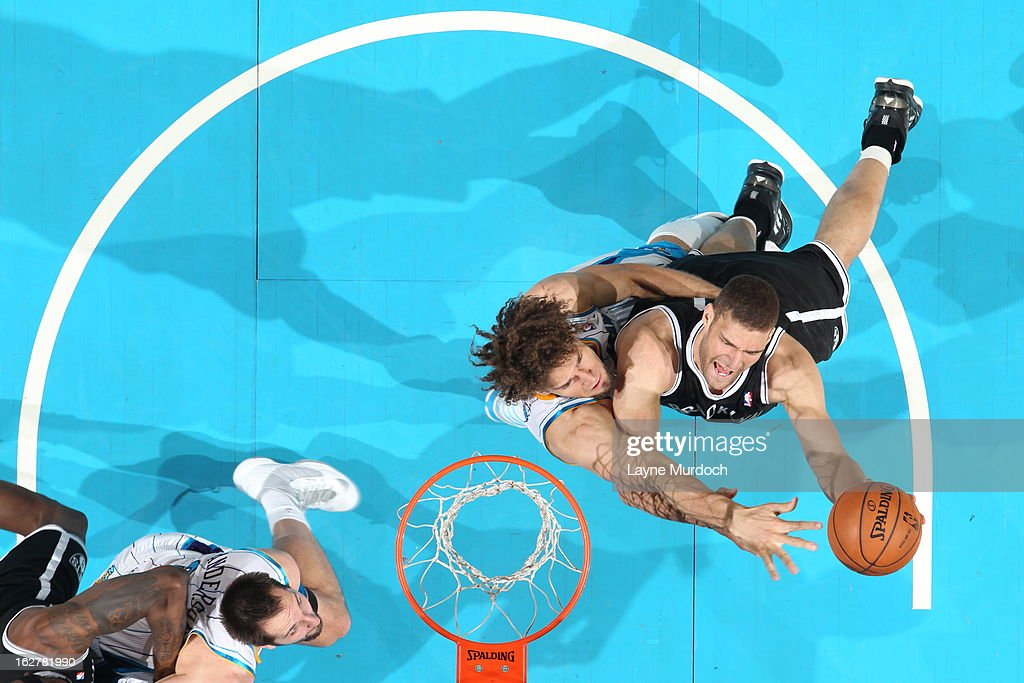 <a gi-track='captionPersonalityLinkClicked' href=/galleries/search?phrase=Brook+Lopez&family=editorial&specificpeople=3847328 ng-click='$event.stopPropagation()'>Brook Lopez</a> #11 of the Brooklyn Nets shoots against <a gi-track='captionPersonalityLinkClicked' href=/galleries/search?phrase=Robin+Lopez&family=editorial&specificpeople=2351509 ng-click='$event.stopPropagation()'>Robin Lopez</a> #15 of the New Orleans Hornets on February 26, 2013 at the New Orleans Arena in New Orleans, Louisiana.