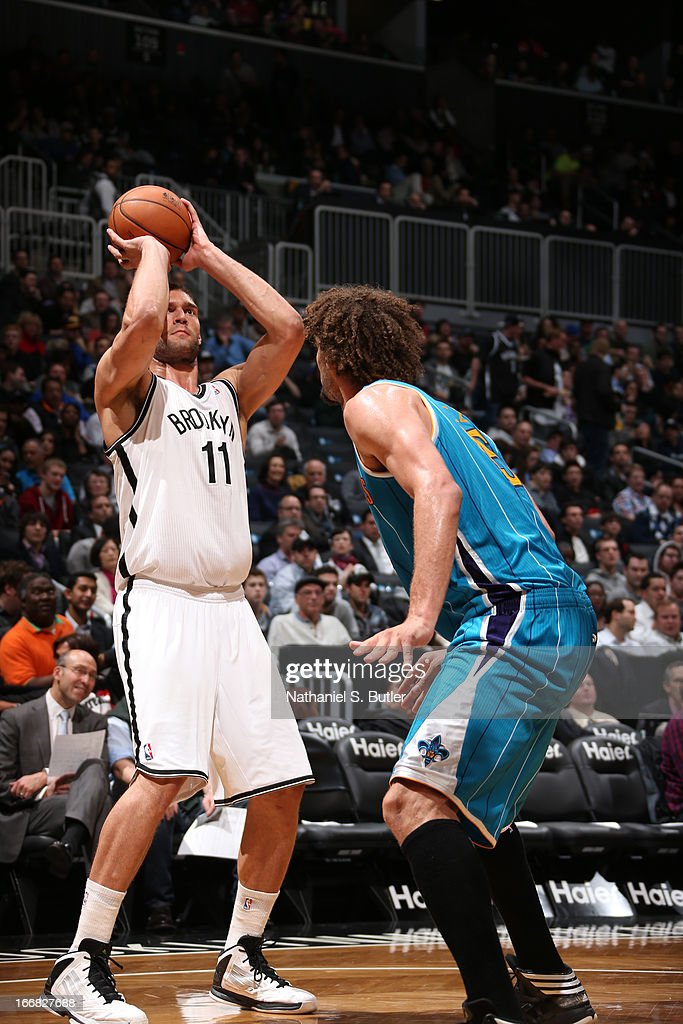 Brook Lopez #11 of the Brooklyn Nets shoots against <a gi-track='captionPersonalityLinkClicked' href=/galleries/search?phrase=Robin+Lopez&family=editorial&specificpeople=2351509 ng-click='$event.stopPropagation()'>Robin Lopez</a> #15 of the New Orleans Hornets on March 12, 2013 at the Barclays Center in the Brooklyn borough of New York City.