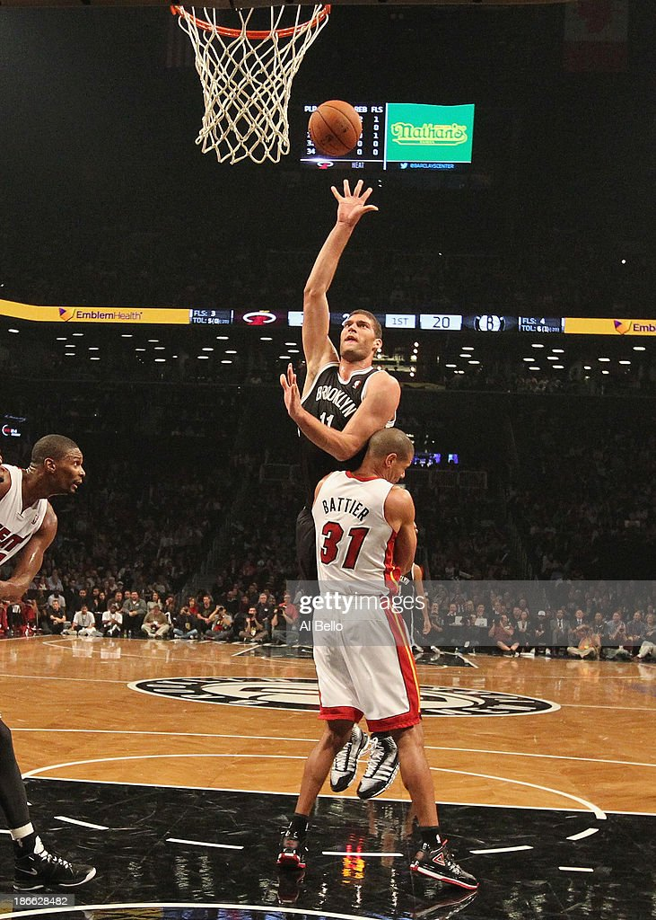 <a gi-track='captionPersonalityLinkClicked' href=/galleries/search?phrase=Brook+Lopez&family=editorial&specificpeople=3847328 ng-click='$event.stopPropagation()'>Brook Lopez</a> #11 of the Brooklyn Nets shoots against <a gi-track='captionPersonalityLinkClicked' href=/galleries/search?phrase=Shane+Battier&family=editorial&specificpeople=201814 ng-click='$event.stopPropagation()'>Shane Battier</a> #31 of the Miami Heat during their game at the Barclays Center on November 1, 2013 in the Brooklyn borough of New York City.