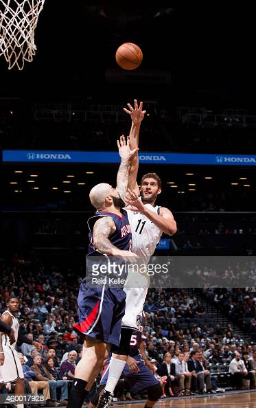 Brook Lopez of the Brooklyn Nets shoots against the Atlanta Hawks on December 5 2014 at the Barclays Center in the Brooklyn borough of New York City...