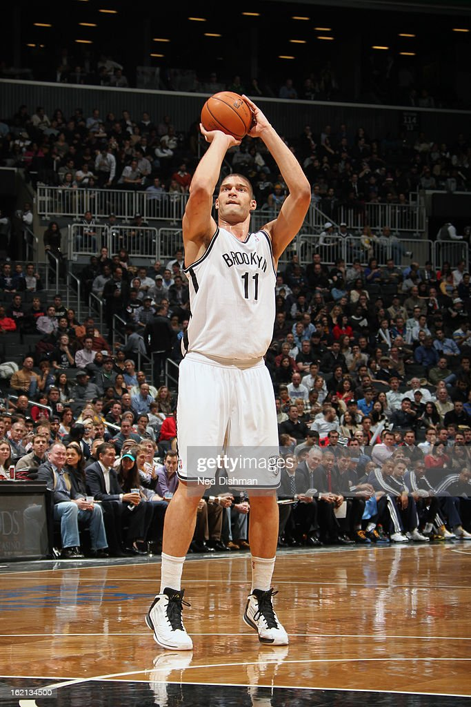 <a gi-track='captionPersonalityLinkClicked' href=/galleries/search?phrase=Brook+Lopez&family=editorial&specificpeople=3847328 ng-click='$event.stopPropagation()'>Brook Lopez</a> #11 of the Brooklyn Nets shoots against the Denver Nuggets on February 13, 2013 at the Barclays Center in the Brooklyn borough of New York City in New York City.