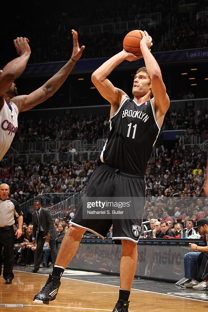 Brook Lopez #11 of the Brooklyn Nets shoots against the Los Angeles Clippers on November 23, 2012 at the Barclays Center in the Brooklyn Borough of New York City.