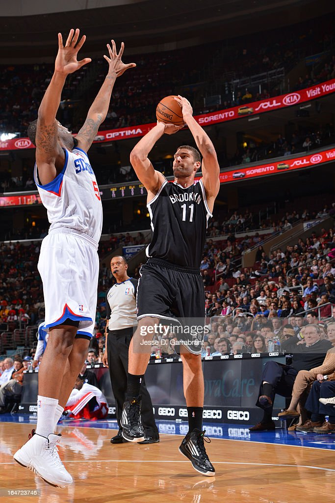 <a gi-track='captionPersonalityLinkClicked' href=/galleries/search?phrase=Brook+Lopez&family=editorial&specificpeople=3847328 ng-click='$event.stopPropagation()'>Brook Lopez</a> #11 of the Brooklyn Nets shoots against the Philadelphia 76ers at the Wells Fargo Center on March 11, 2013 in Philadelphia, Pennsylvania.