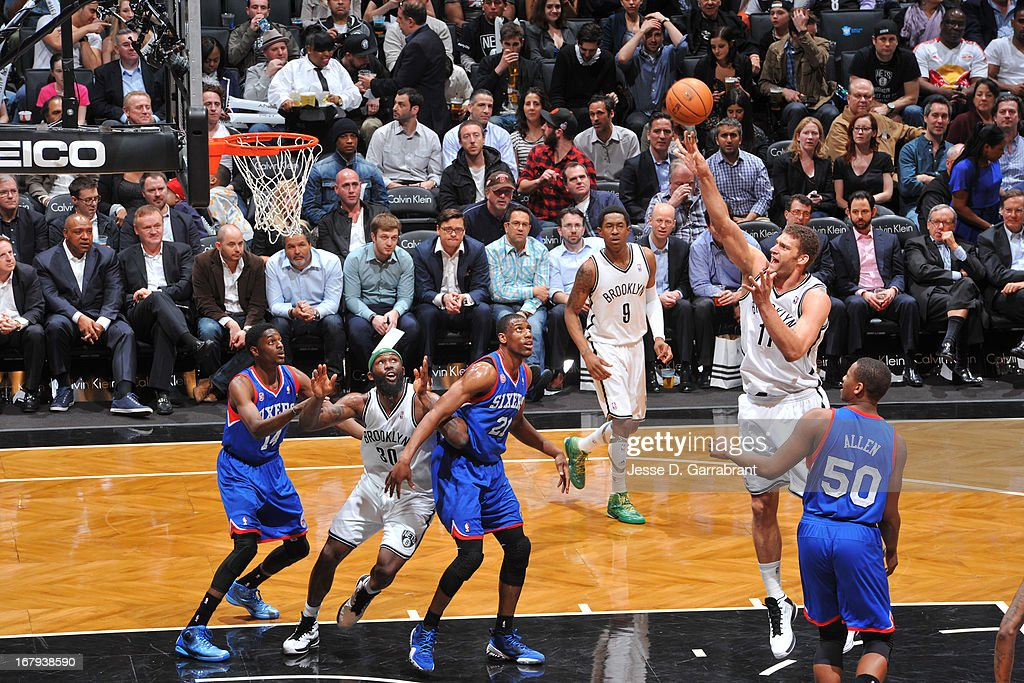 <a gi-track='captionPersonalityLinkClicked' href=/galleries/search?phrase=Brook+Lopez&family=editorial&specificpeople=3847328 ng-click='$event.stopPropagation()'>Brook Lopez</a> #11 of the Brooklyn Nets shoots against the Philadelphia 76ers on April 9, 2013 at the Barclays Center in Brooklyn, New York.