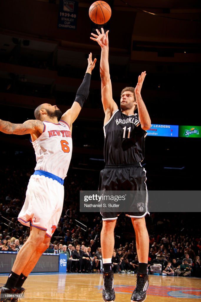 Brook Lopez #11 of the Brooklyn Nets shoots against Tyson Chandler #6 of the New York Knicks on January 21, 2013 at Madison Square Garden in New York City.