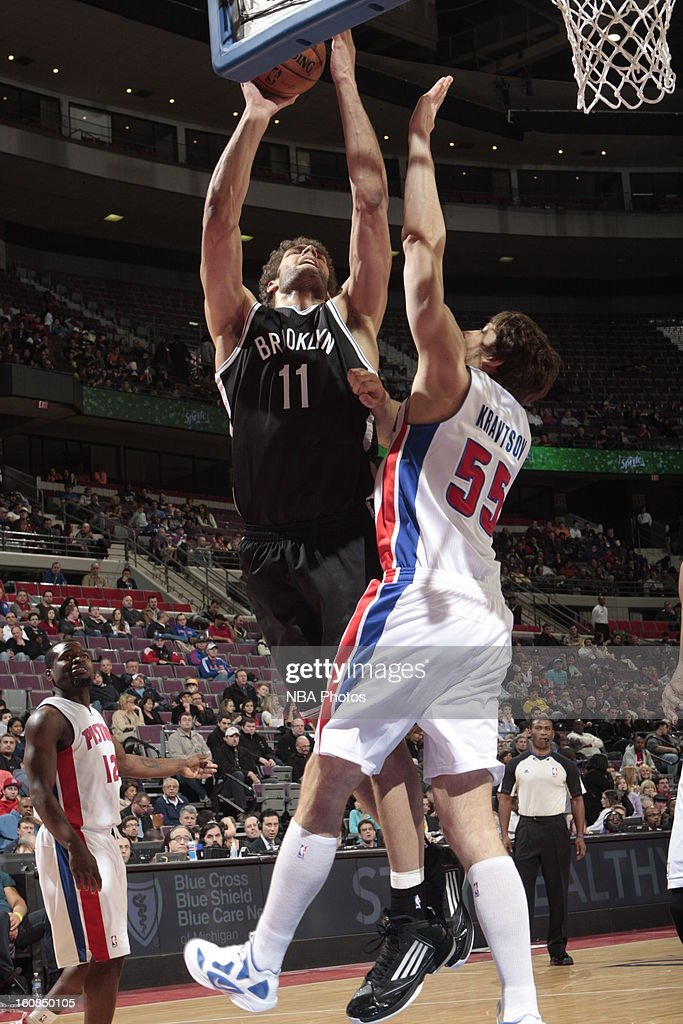 Brook Lopez #11 of the Brooklyn Nets shoots against Viacheslav Kravtsov #55 of the Detroit Pistons on February 6, 2013 at The Palace of Auburn Hills in Auburn Hills, Michigan.
