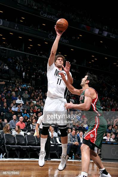 Brook Lopez of the Brooklyn Nets shoots against Zaza Pachulia of the Milwaukee Bucks on March 20 2015 at Barclays Center in Brooklyn New York NOTE TO...