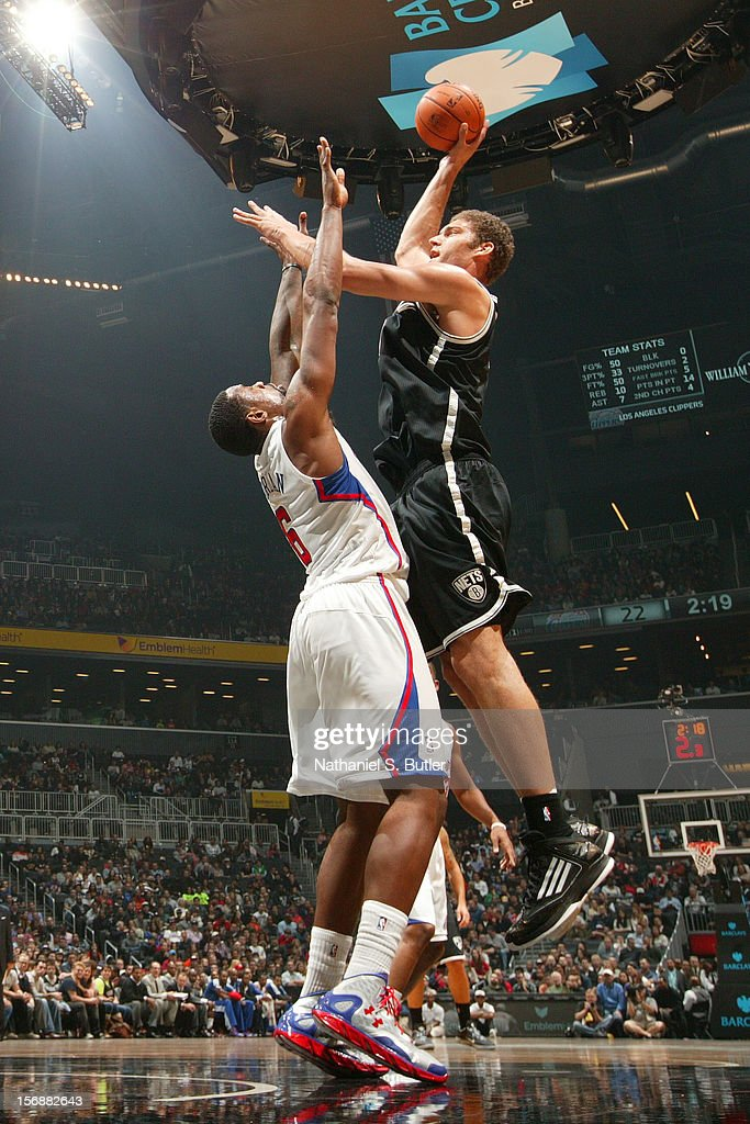 Brook Lopez #11 of the Brooklyn Nets shoots over DeAndre Jordan #6 of the Los Angeles Clippers on November 23, 2012 at the Barclays Center in the Brooklyn Borough of New York City.