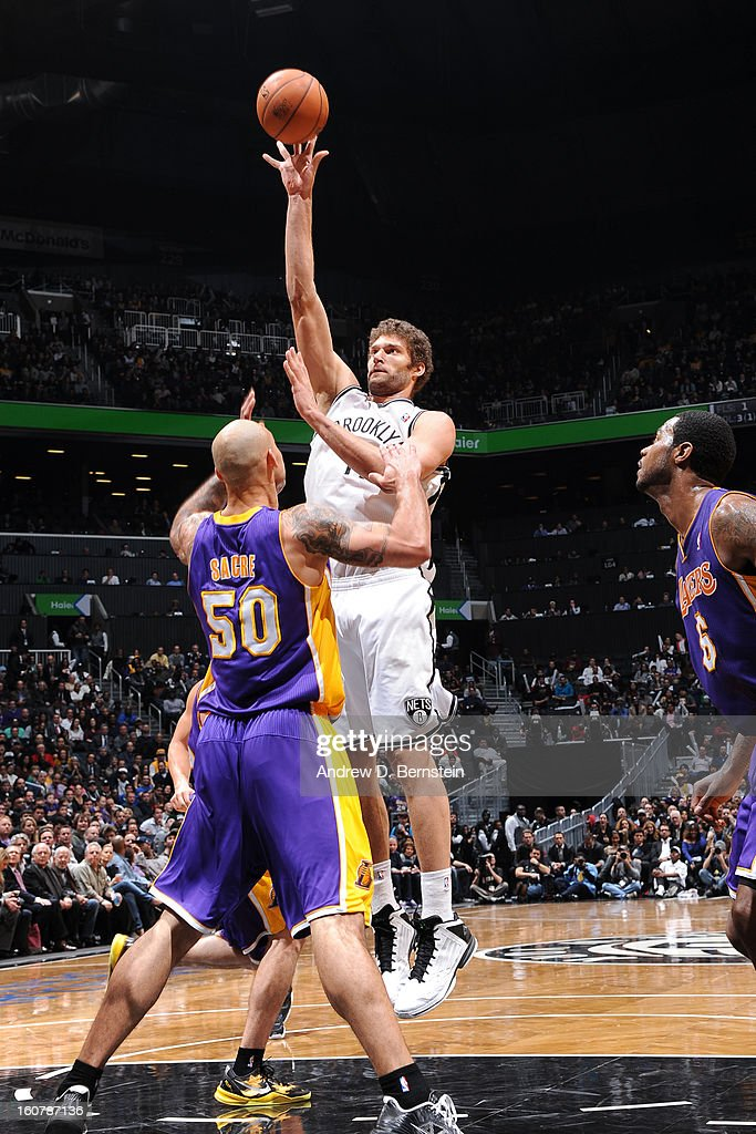 Brook Lopez #11 of the Brooklyn Nets shoots over Robert Sacre #50 of the Los Angeles Lakers on February 5, 2013 at the Barclays Center in the Brooklyn borough of New York City.