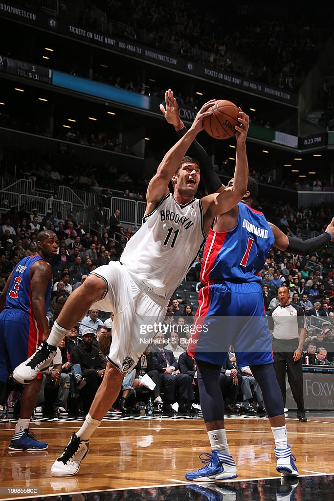 Brook Lopez #11 of the Brooklyn Nets shoots past Andre Drummond #1 of the Detroit Pistons on April 17, 2013 at the Barclays Center in the Brooklyn borough of New York City.