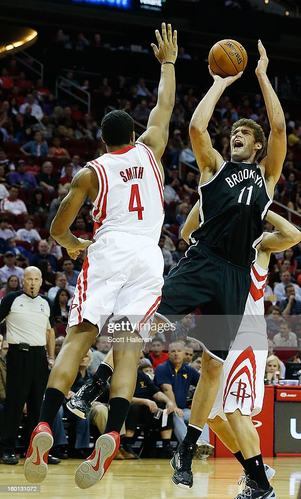 Brook Lopez #11 of the Brooklyn Nets shoots the ball over Greg Smith #4 of the Houston Rockets at Toyota Center on January 26, 2013 in Houston, Texas.