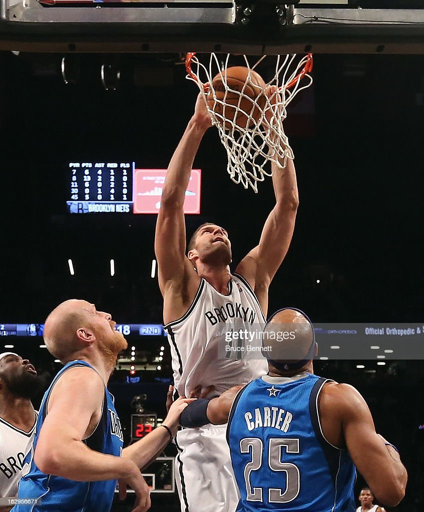 Brook Lopez #11 of the Brooklyn Nets sinks a basket against the Dallas Mavericks at the Barclays Center on March 1, 2013 in New York City. The Mavericks defeated the Nets 98-90.