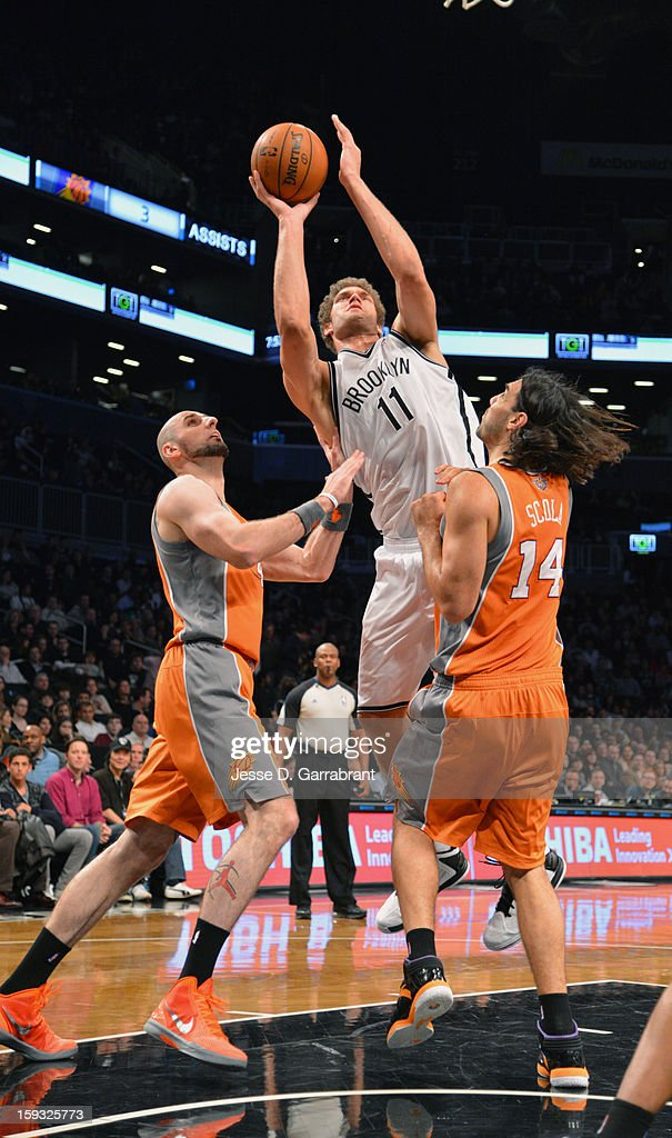 Brook Lopez #11 of the Brooklyn Nets takes a shot against Luis Scola #14 of the Phoenix Suns during the game at the Barclays Center on January 11, 2013 in Brooklyn, New York.