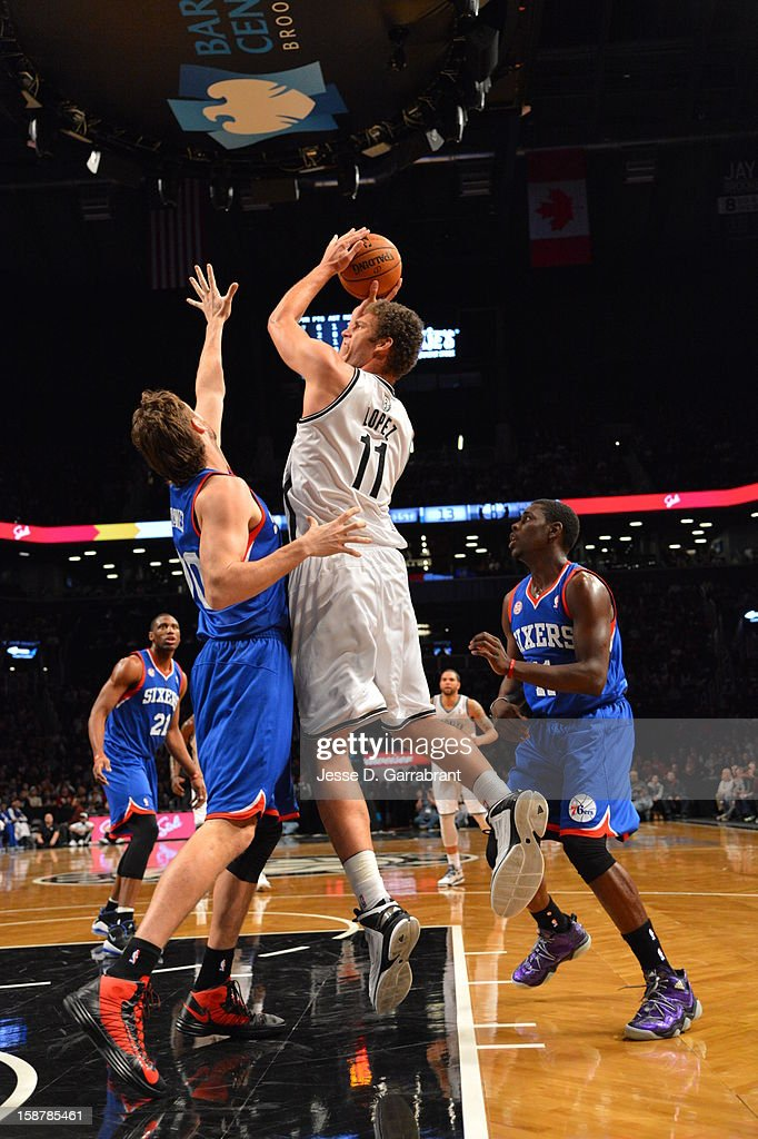 <a gi-track='captionPersonalityLinkClicked' href=/galleries/search?phrase=Brook+Lopez&family=editorial&specificpeople=3847328 ng-click='$event.stopPropagation()'>Brook Lopez</a> #11 of the Brooklyn Nets takes a shot against the Philadelphia 76ers at the Barclays Center on December 23, 2012 in Brooklyn, New York.