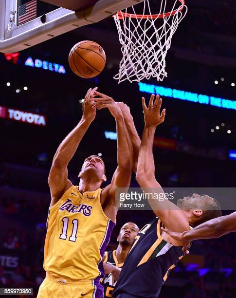 Brook Lopez of the Los Angeles Lakers and Rudy Gobert of the Utah Jazz rebound during the first half at Staples Center on October 10 2017 in Los...