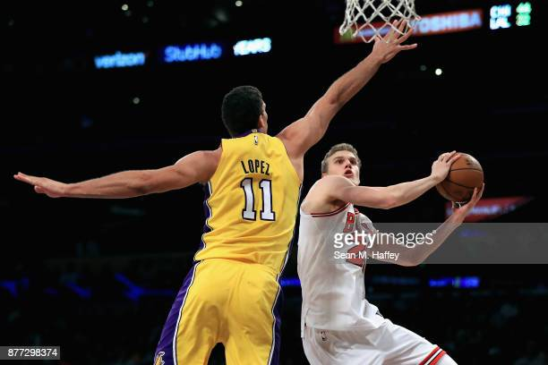 Brook Lopez of the Los Angeles Lakers defends against Lauri Markkanen of the Chicago Bulls during the first half of a game at Staples Center on...
