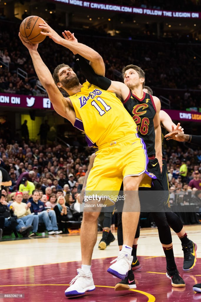 Brook Lopez #11 of the Los Angeles Lakers fights for a rebound with Kyle Korver #26 of the Cleveland Cavaliers during the first half at Quicken Loans Arena on December 14, 2017 in Cleveland, Ohio.