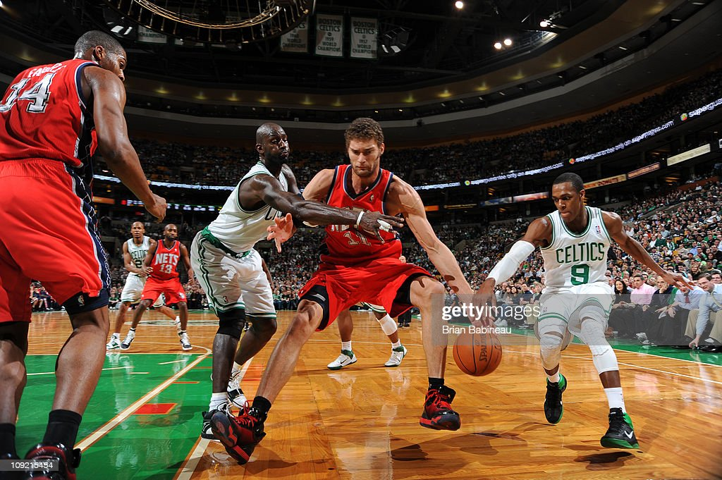 df56b11117e9 ... Brook Lopez 11 of the New Jersey Nets battles for the loose ball against  Kevin ...