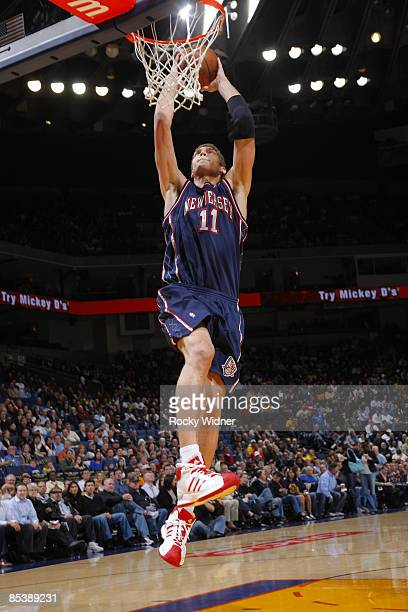 Brook Lopez of the New Jersey Nets dunks against the Golden State Warriors on March 11 2009 at Oracle Arena in Oakland California NOTE TO USER User...