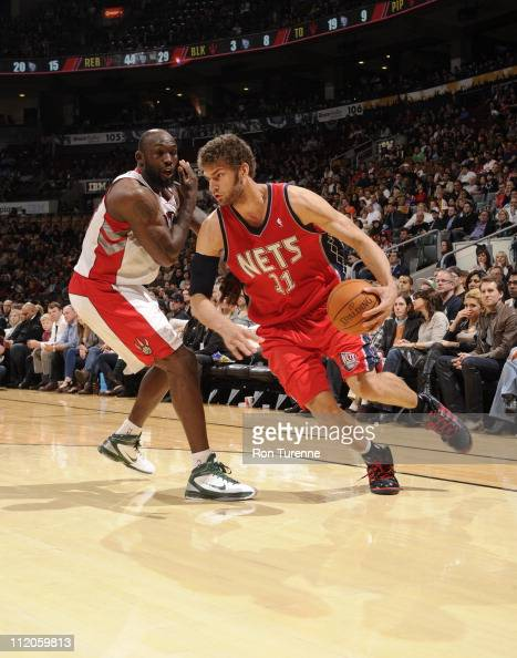 Brook Lopez of the New Jersey Nets in action against Reggie Evans of the Toronto Raptors on April 10 2011 at the Air Canada Centre in Toronto Ontario...