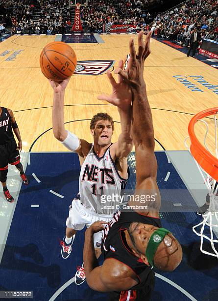 Brook Lopez of the New Jersey Nets shoots against Erick Dampier of the Miami Heat on April 3 2011 at the Prudential Center in Newark New Jersey NOTE...