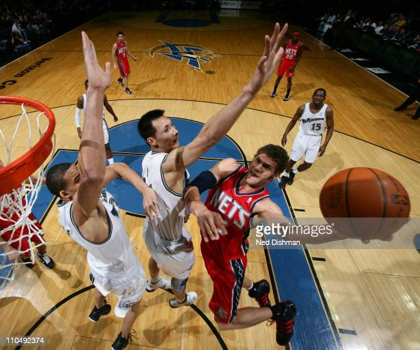 Brook Lopez of the New Jersey Nets shoots against Yi Jianlian of the Washington Wizards at the Verizon Center on March 20 2011 in Washington DC NOTE...