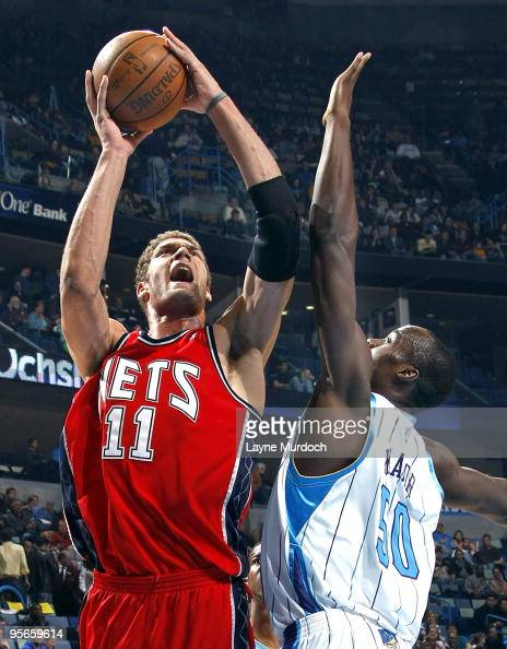Brook Lopez of the New Jersey Nets shoots over Emeka Okafor of the New Orleans Hornets on January 8 2010 at the New Orleans Arena in New Orleans...