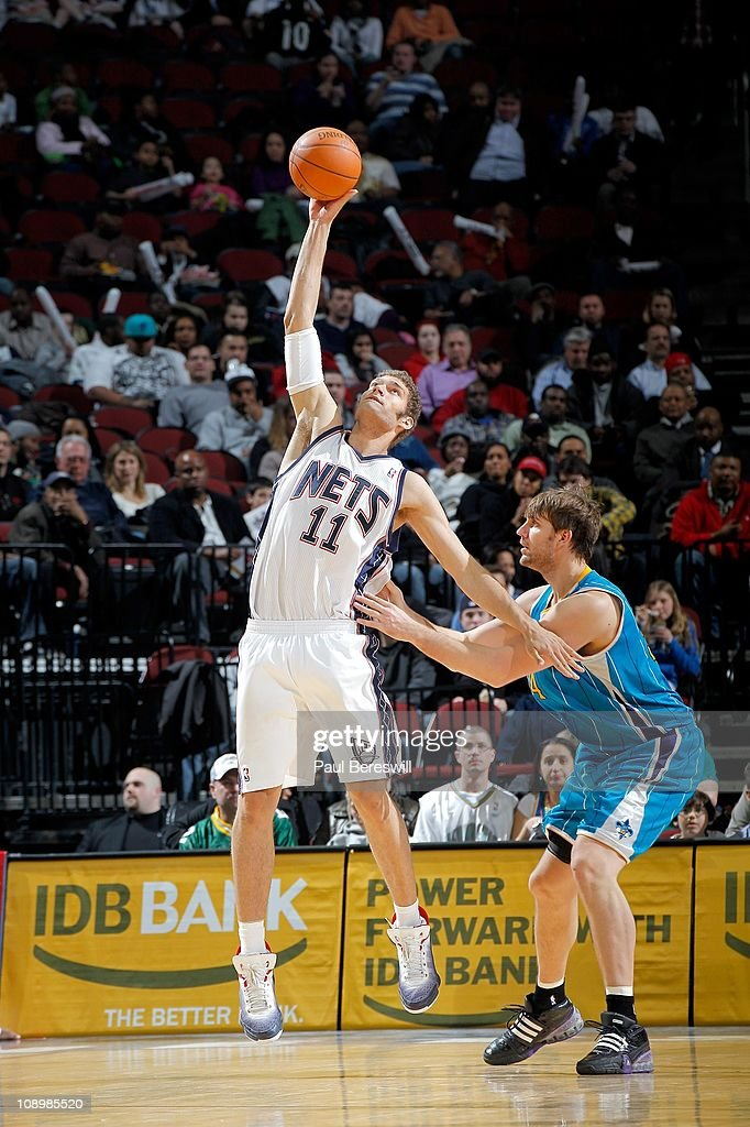 Brook Lopez of the New Jersey Nets shoots the ball against the New Orleans Hornets of the New Orleans Hornets against of the New Jersey Nets on...
