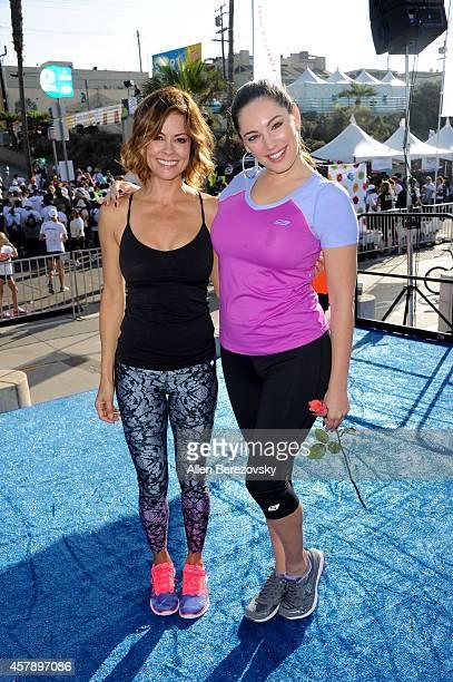 Brooke BurkeCharvet and Kelly Brook attend the Skechers Pier to Pier Friendship Walk at Manhattan Beach Pier on October 26 2014 in Manhattan Beach...