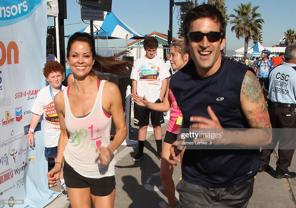 <a gi-track='captionPersonalityLinkClicked' href=/galleries/search?phrase=Brooke+Burke&family=editorial&specificpeople=203216 ng-click='$event.stopPropagation()'>Brooke Burke</a>-Charvet and Steven Lake attend the 4th Annual SKECHERS Pier to Pier Friendship Walk on October 28, 2012 in Manhattan Beach, California.
