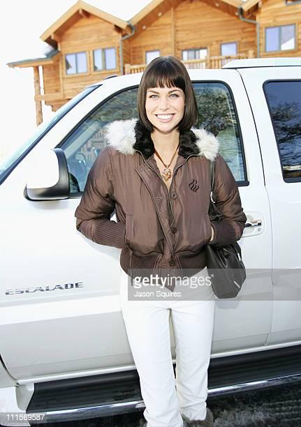 Brooke Burns takes a break before riding into Park City in a 2005 Cadillac Escalade ESV