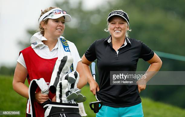 Brooke Henderson Canada waits with her sister/caddie Brittany on the 14th hole during the final round of the US Women's Open at Lancaster Country...