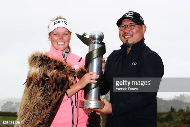 Brooke Henderson of Canada is presented the New Zealand Women's Open trophy by MC Kim during day five of the New Zealand Women's Open at Windross...