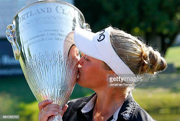 Brooke Henderson of Canada kisses the trophy after her 21 strokes under par victory during the final round of the LPGA Cambia Portland Classic at...