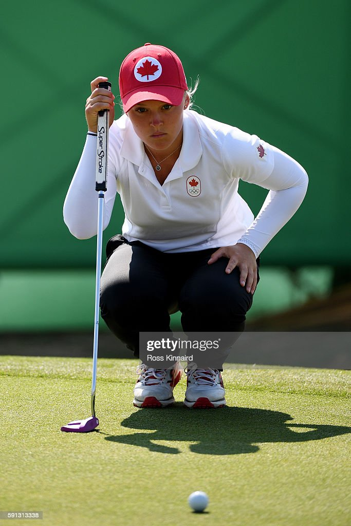 Brooke Henderson of Canada lines up a putt on the third green during the First Round of Women's Golf at Olympic Golf Course on Day 12 of the Rio 2016...