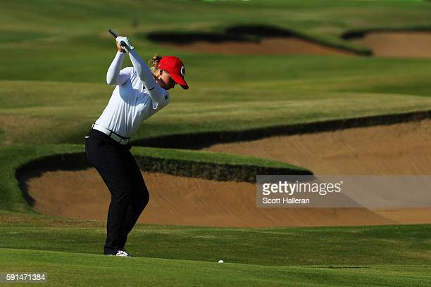 Brooke Henderson of Canada plays a shot on the 18th hole during the First Round of Women's Golf on Day 12 of the Rio 2016 Olympic Games at Olympic...
