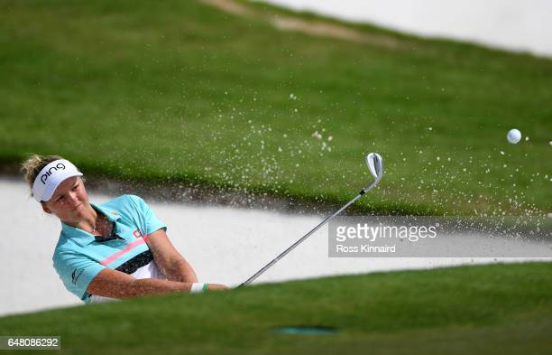 Brooke Henderson of Canada plays her third shot on the par five 5th hole during the final round of the HSBC Women's Champions on the Tanjong course...