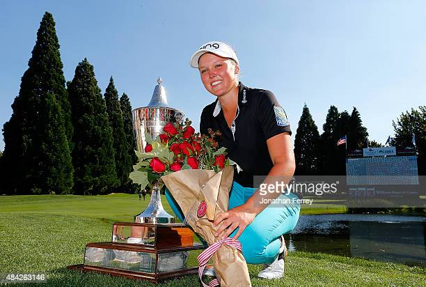 Brooke Henderson of Canada poses with the trophy after her 21 strokes under par victory during the final round of the LPGA Cambia Portland Classic at...