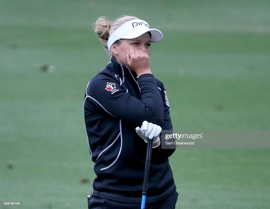 <a gi-track='captionPersonalityLinkClicked' href=/galleries/search?phrase=Brooke+Henderson&family=editorial&specificpeople=9660433 ng-click='$event.stopPropagation()'>Brooke Henderson</a> of Canada waits to play a shot on the eighth hole during the final round of the Coates Golf Championship Presented By R+L Carriers at Golden Ocala Golf Club on February 6, 2016 in Ocala, Florida.