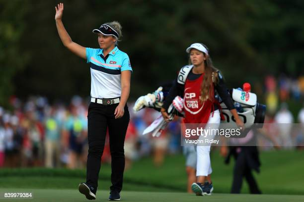 Brooke Henderson of Canada waves to teh crowd as she walks up to the 18th green during the final round of the Canadian Pacific Women's Open at the...