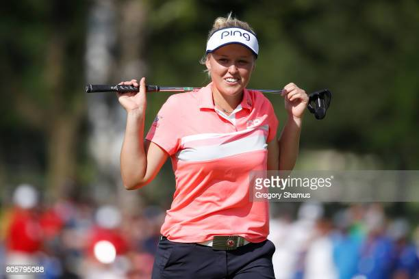 Brooke Henderson reacts to a missed eagle putt on the 18th green during the finial round of the 2017 KPMG PGA Championship at Olympia Fields Country...