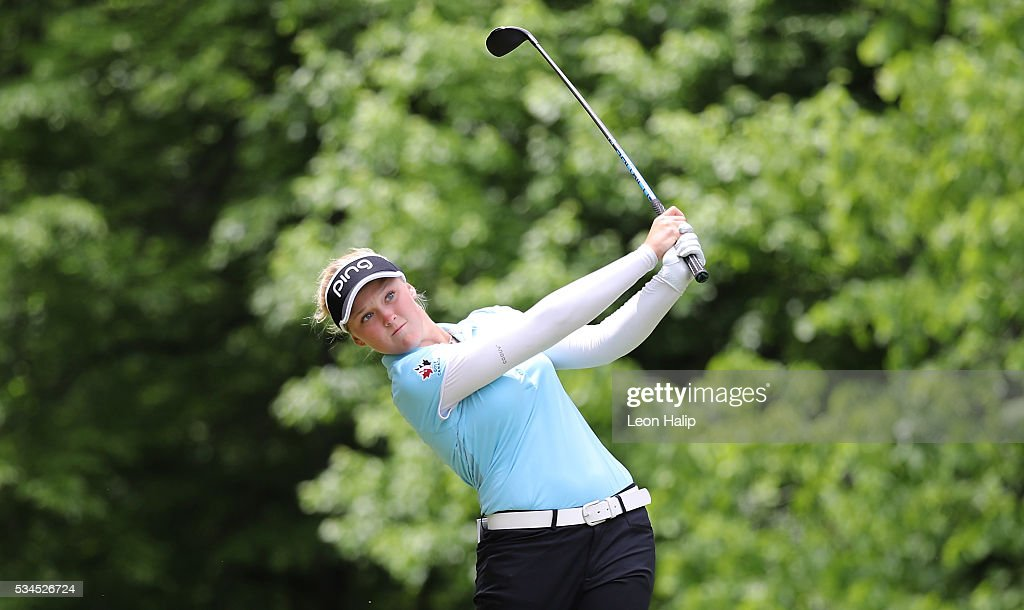 <a gi-track='captionPersonalityLinkClicked' href=/galleries/search?phrase=Brooke+Henderson&family=editorial&specificpeople=9660433 ng-click='$event.stopPropagation()'>Brooke Henderson</a> tees off on the seventh hole during the first round of the LPGA Volvik Championship on May 26, 2016 at Travis Pointe Country Club Ann Arbor, Michigan.