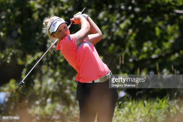 Brooke Henderson watches her tee shot on the fifth hole during the final round of the 2017 KPMG PGA Championship at Olympia Fields Country Club on...