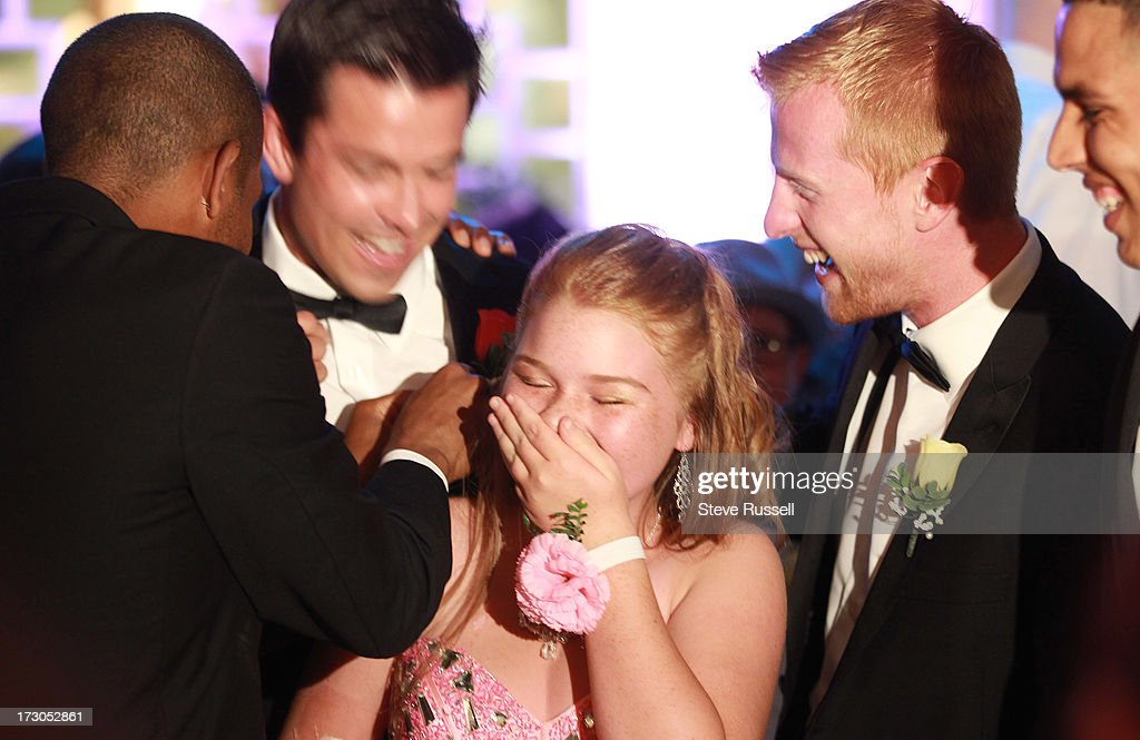 TORONTO, ON- JULY 5 - Brooke Henry, 15, giggles as her as hair gets tangled in the corsage of a Toronto FC player at the annual Prom Night at the Hospital for Sick Children in Toronto, The Hospital puts on a yearly prom for current patients and outpatients. July 5, 2013.