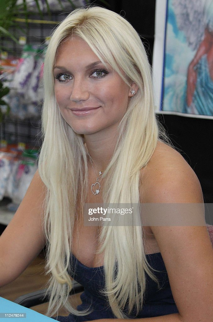 <a gi-track='captionPersonalityLinkClicked' href=/galleries/search?phrase=Brooke+Hogan&family=editorial&specificpeople=206443 ng-click='$event.stopPropagation()'>Brooke Hogan</a> signs copies of her latest CD and greets fans at Walmart on July 25, 2009 in Cooper City, Florida.